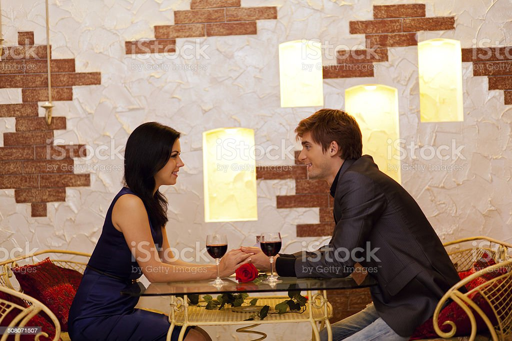 Young happy couple romantic date at restaurant stock photo