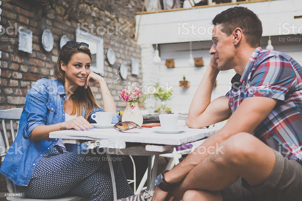 Young happy couple sitting at cafe stock photo