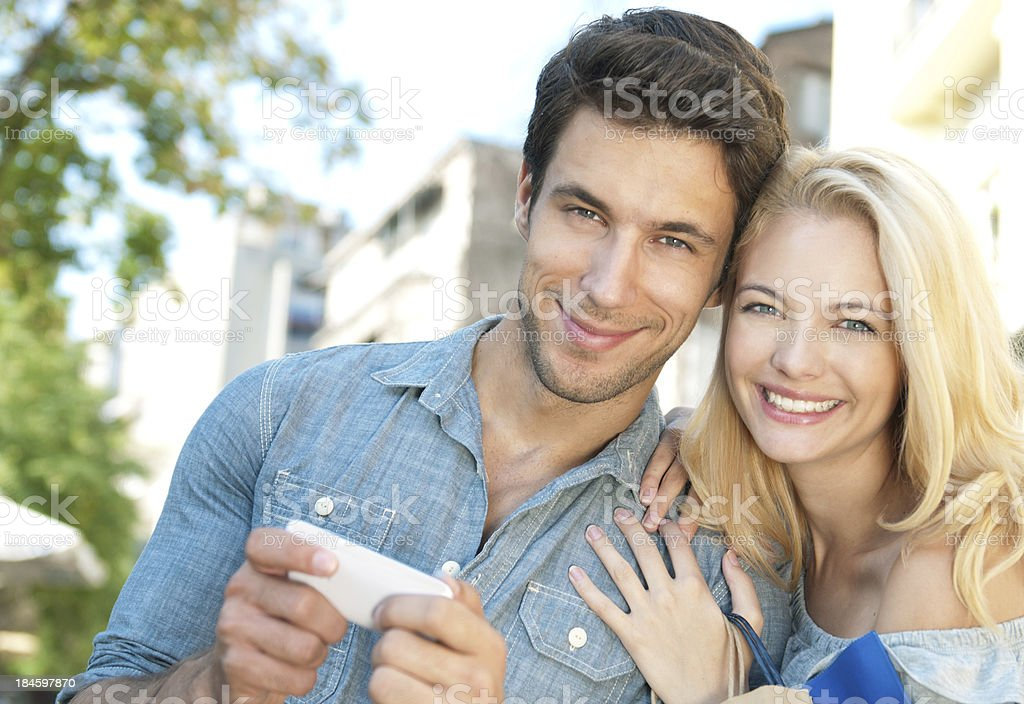young happy couple smiling royalty-free stock photo
