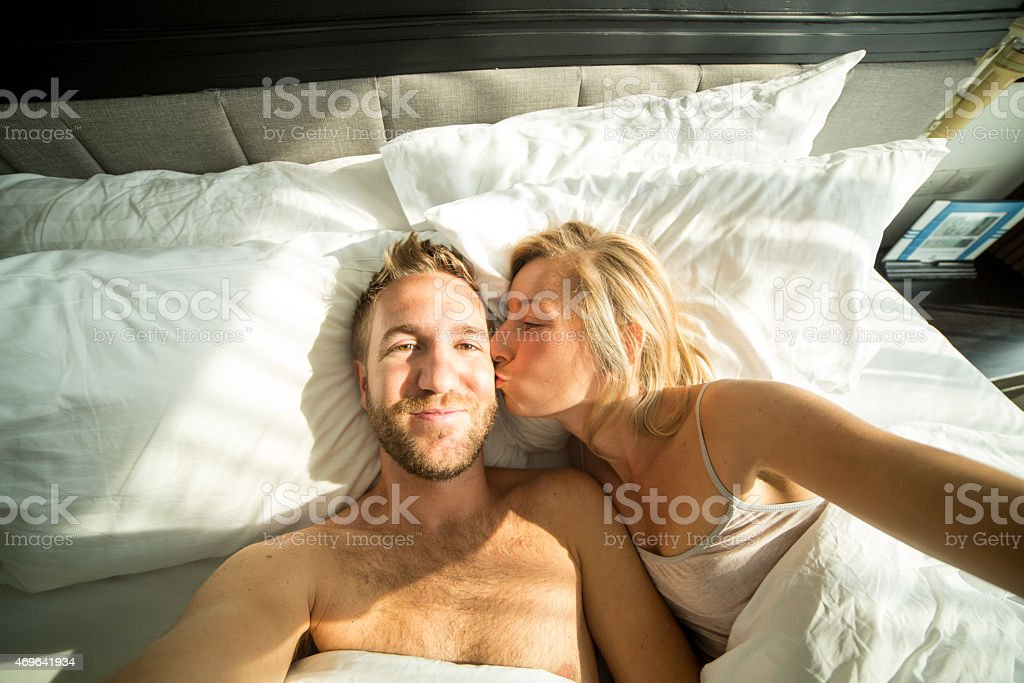 Young happy couple taking selfie stock photo