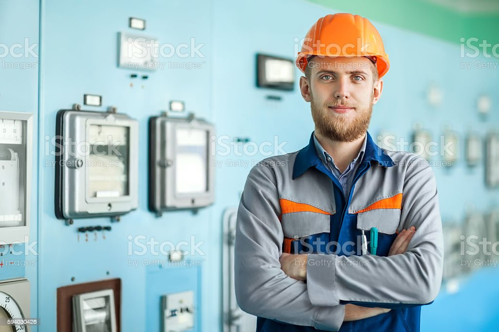 young happy engineer at control room stock photo