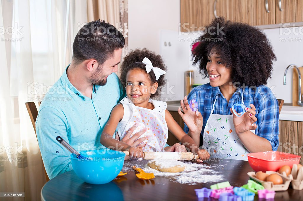 Young happy family baking together stock photo