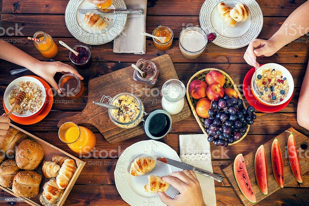 Young Happy Family Having Breakfast stock photo
