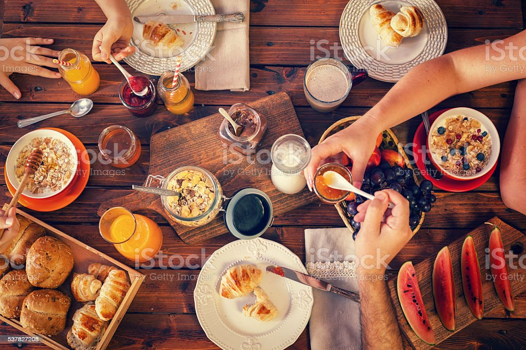 Young Happy Family Having Breakfast stock photo