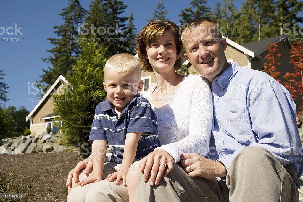 Young happy family of three royalty-free stock photo
