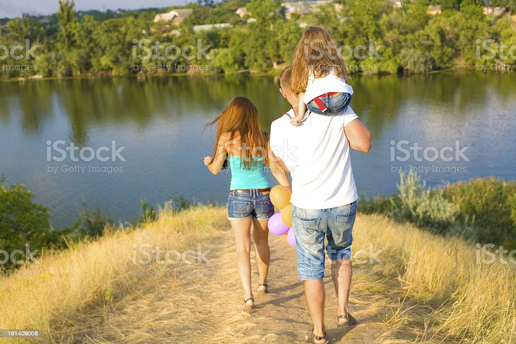 Young happy family outdoor stock photo