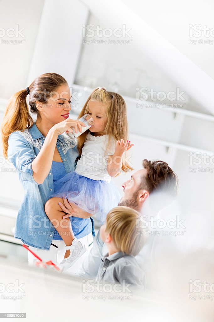 Young happy family spending time in the kitchen. stock photo