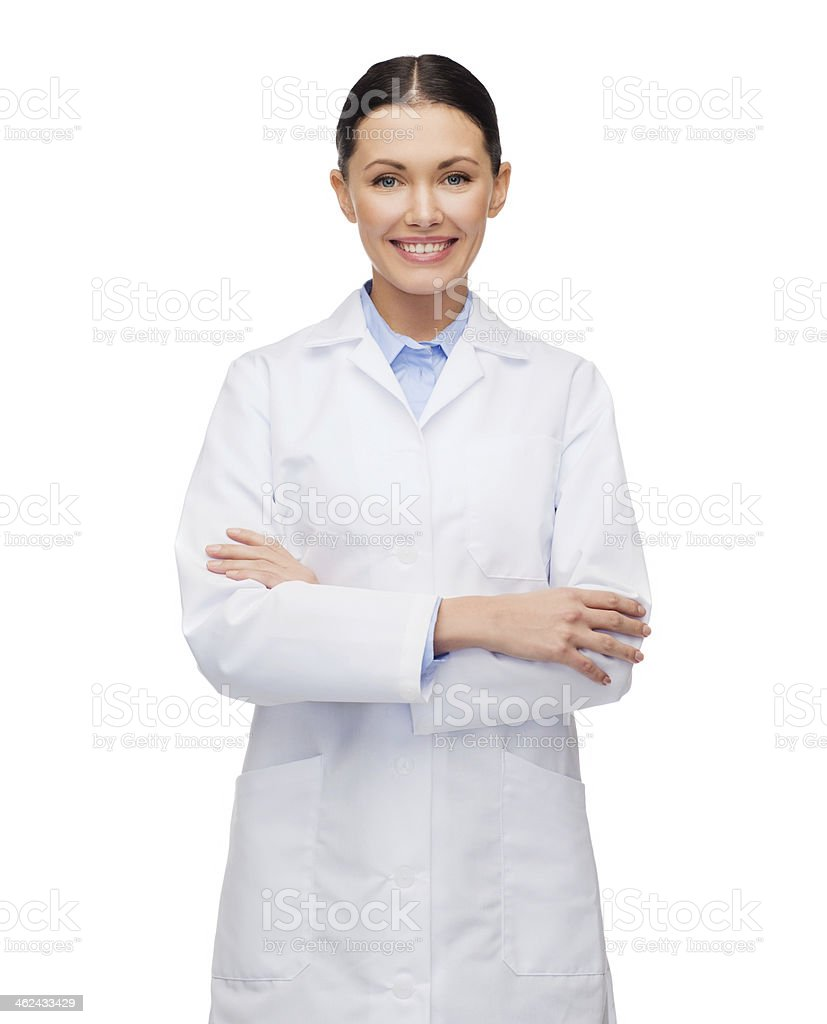 Young happy female doctor with her arms crossed stock photo