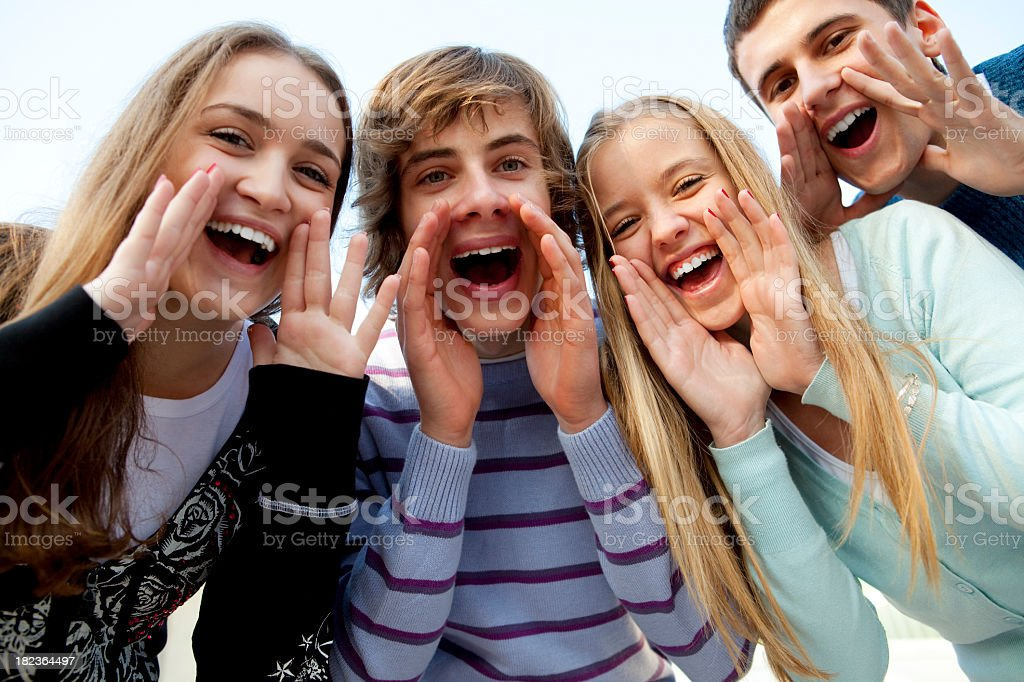 Young happy friends shouting together royalty-free stock photo