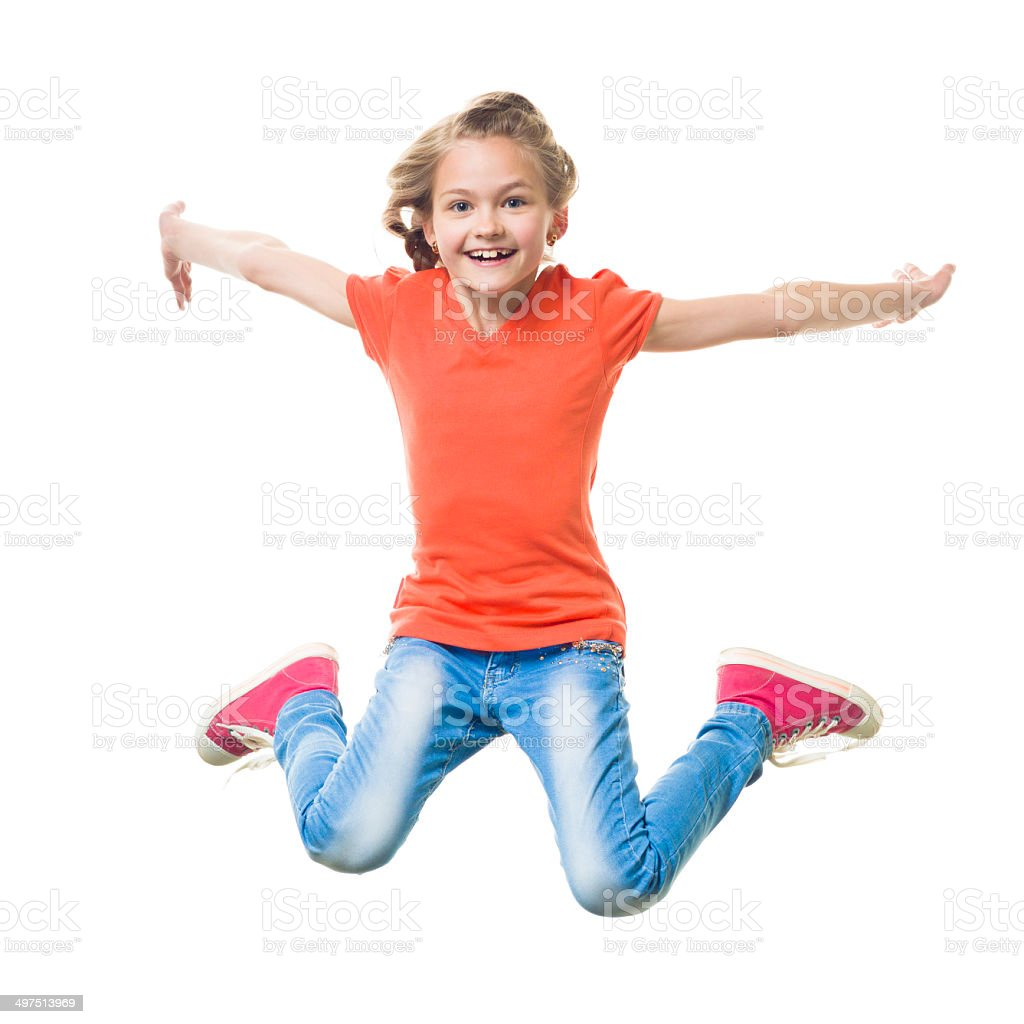 Young happy girl jumping stock photo