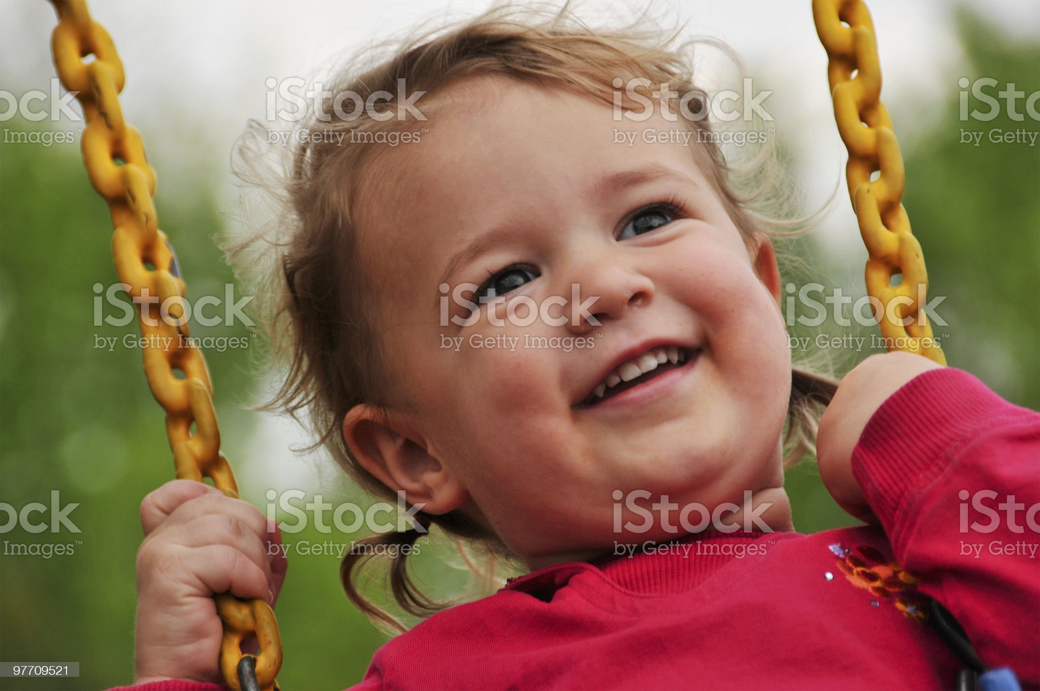 A young happy girl swinging in the spring royalty-free stock photo