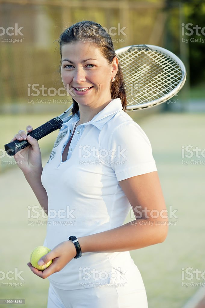 Young happy girl with a tennis racket royalty-free stock photo