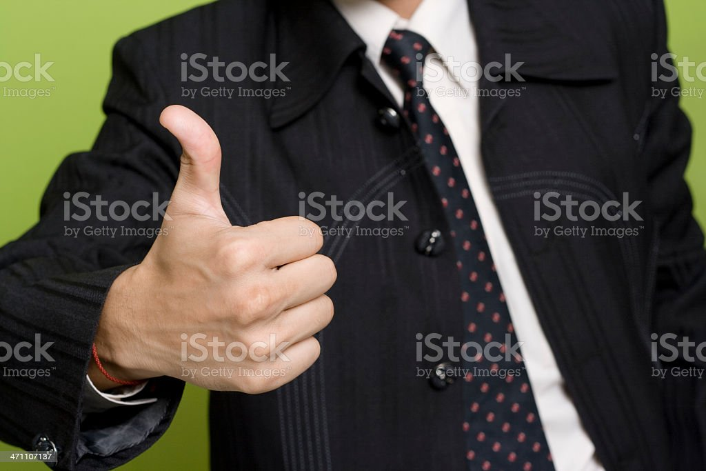Young Happy Indian Businessman with Thumbs Up sign royalty-free stock photo
