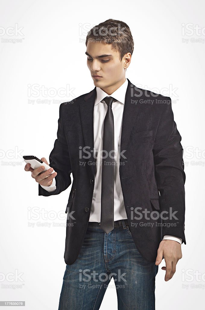 Young happy man holding mobile phone royalty-free stock photo