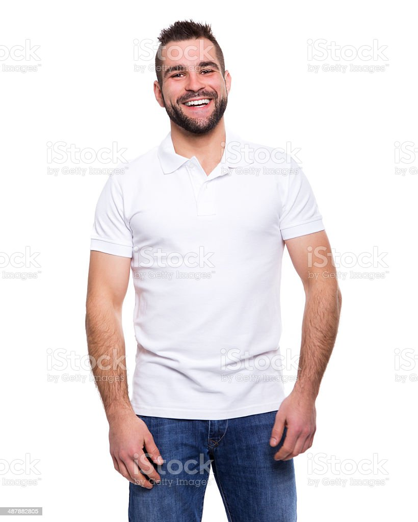 Young happy man in a white polo shirt stock photo