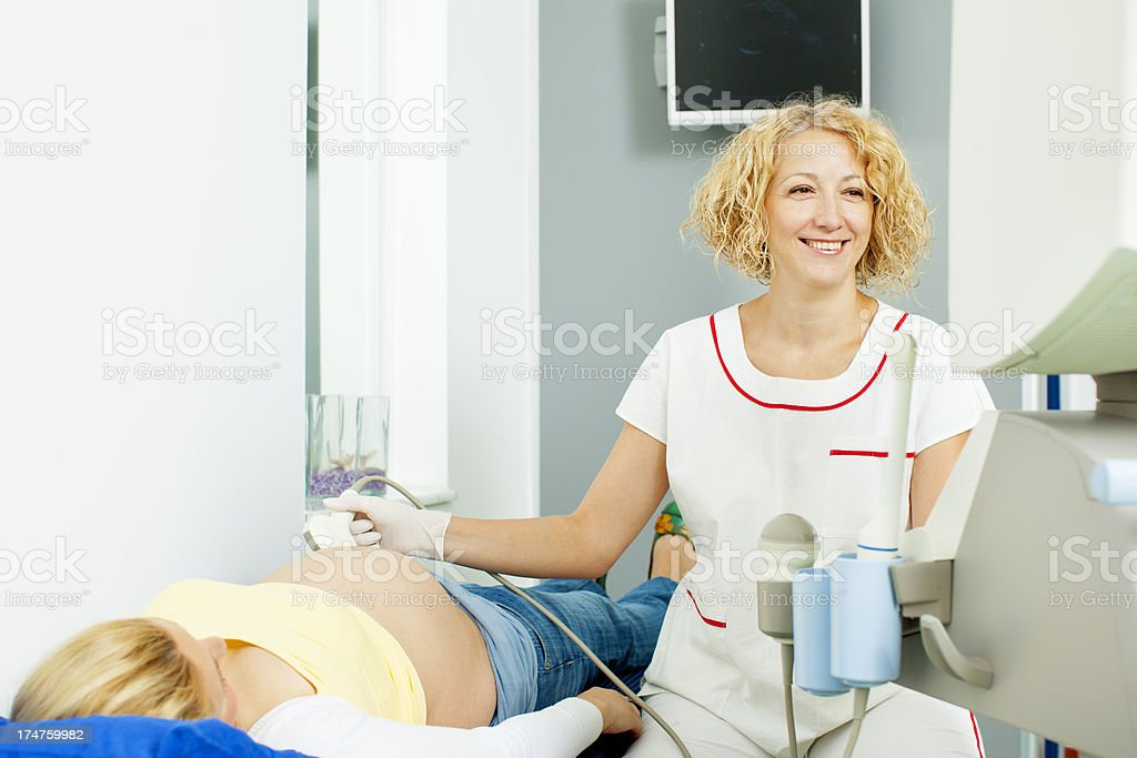 Young Happy pregnant woman having an ultrasound exam. royalty-free stock photo