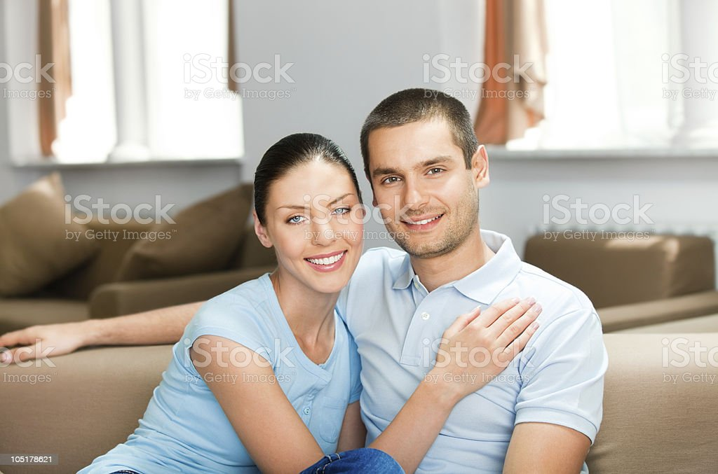 Young happy smiling attractive couple at home royalty-free stock photo