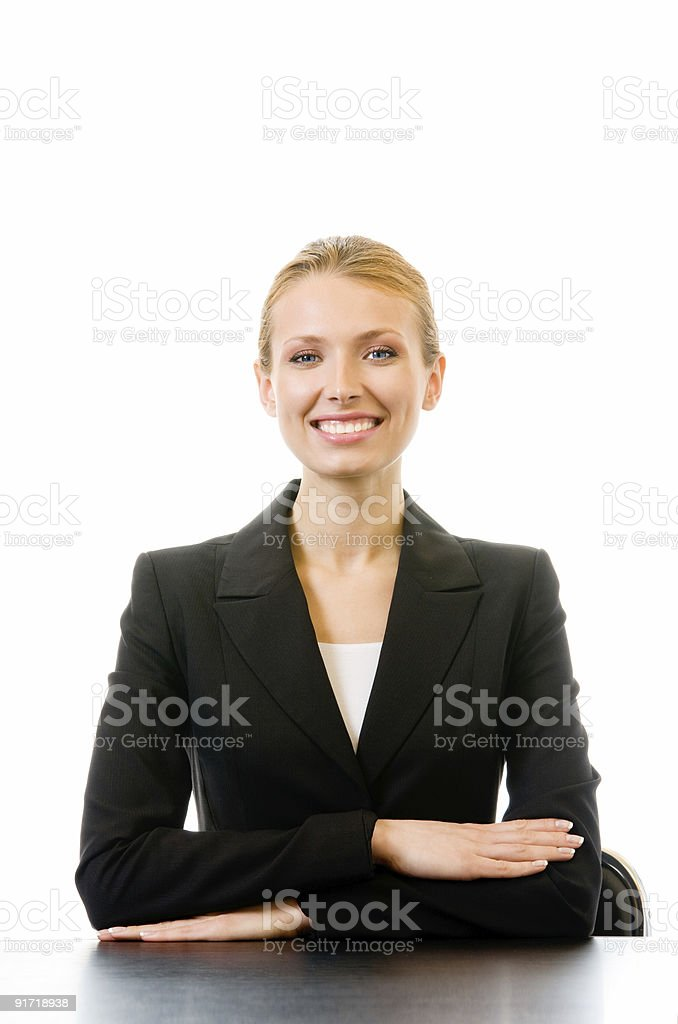 Young happy smiling businesswoman sitting at table, isolated royalty-free stock photo