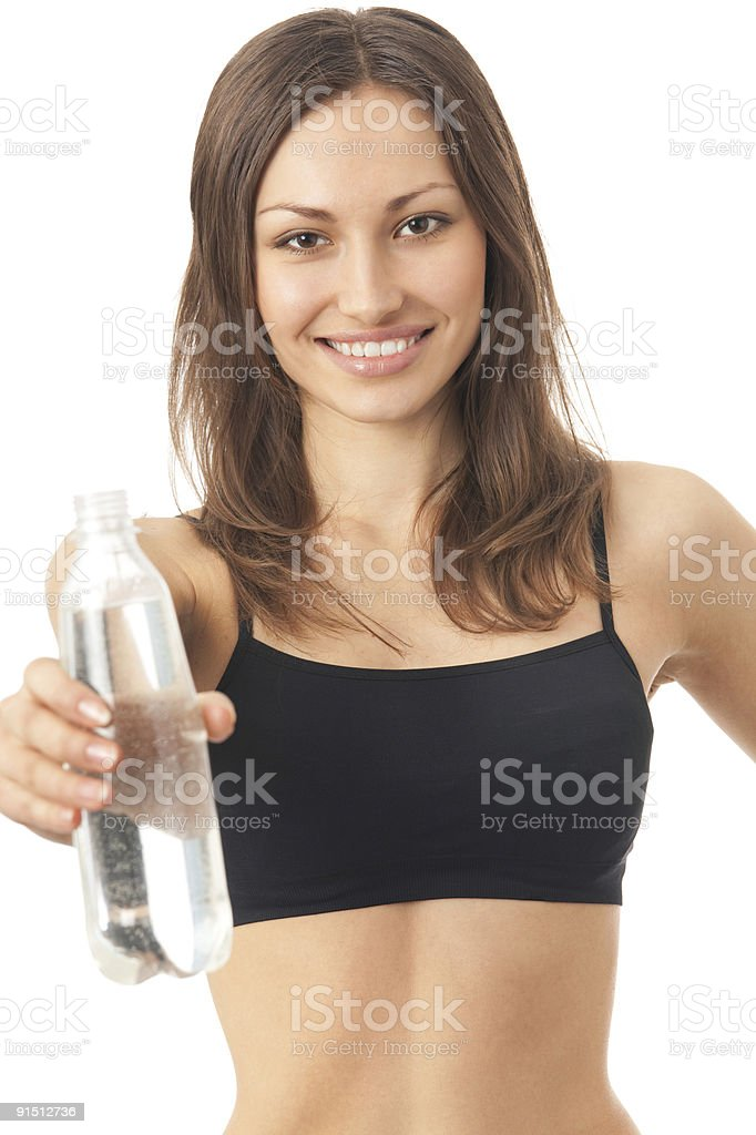 Young happy smiling woman in sportswear with water, isolated royalty-free stock photo