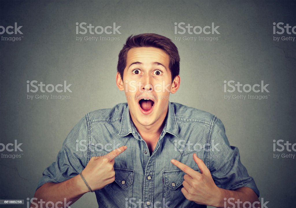 young happy surprised man pointing at himself stock photo