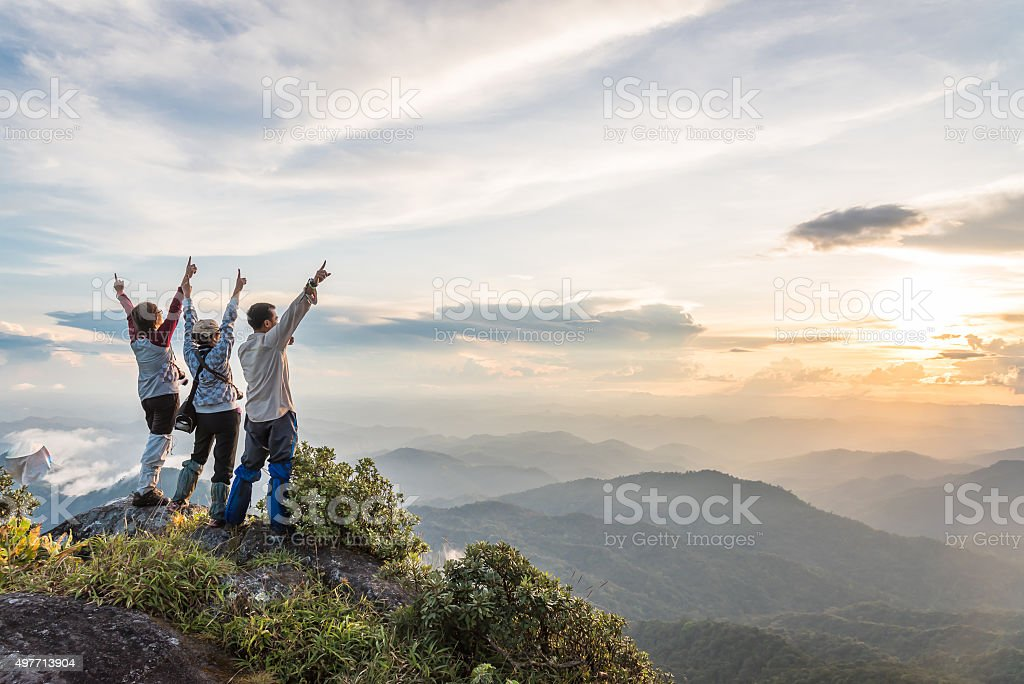 Young happy tourist on top of mountain enjoying valley view stock photo