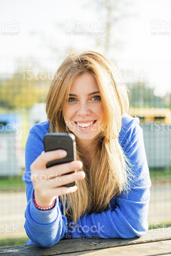 Young happy woman at the park royalty-free stock photo
