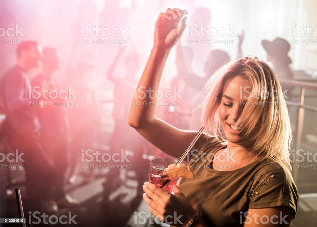 Young happy woman clubbing and dancing on a party. stock photo