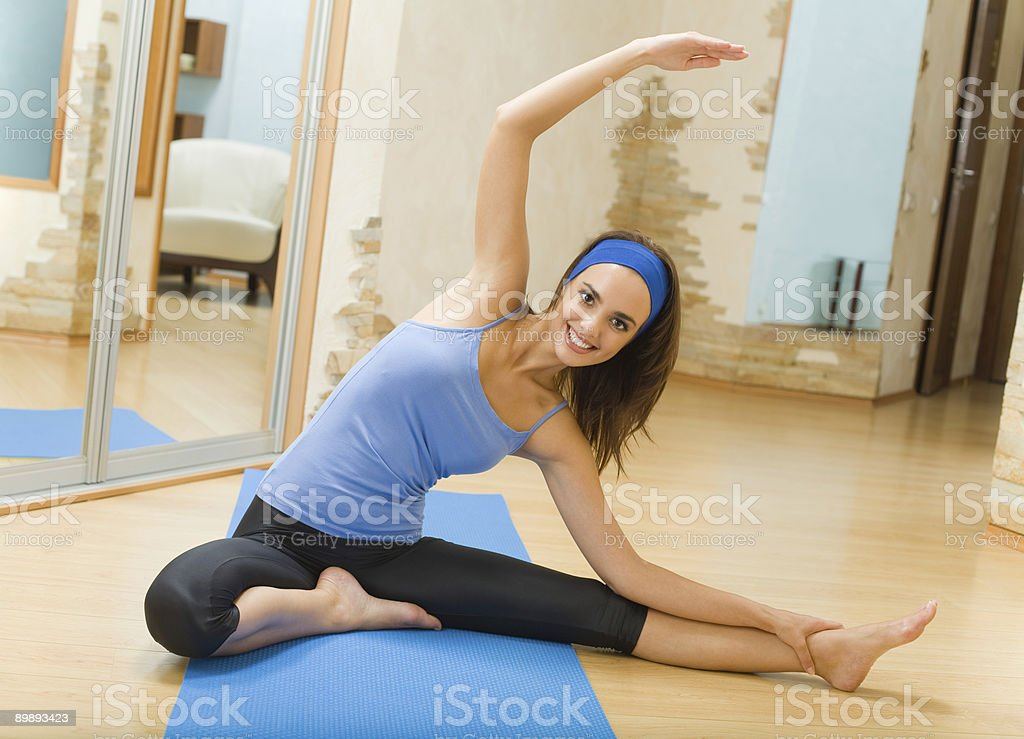 Young happy woman doing fitness exercises at home royalty-free stock photo