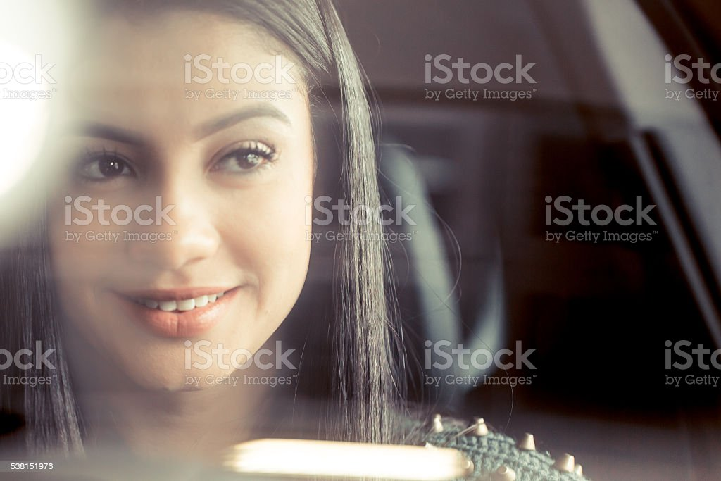 Young happy woman driving stock photo