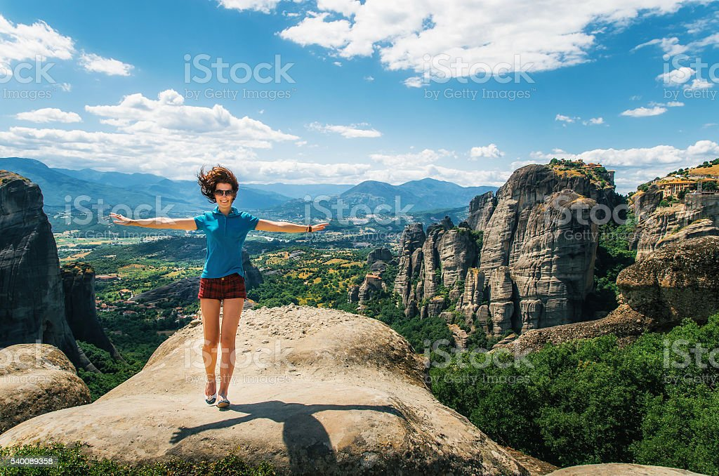 Young happy woman enjoying the landscape in Greece стоковое фото