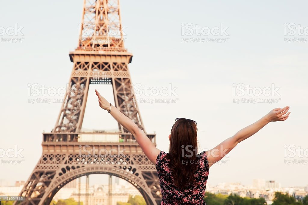 Young happy woman facing the Eiffel Tower, Paris, France stock photo