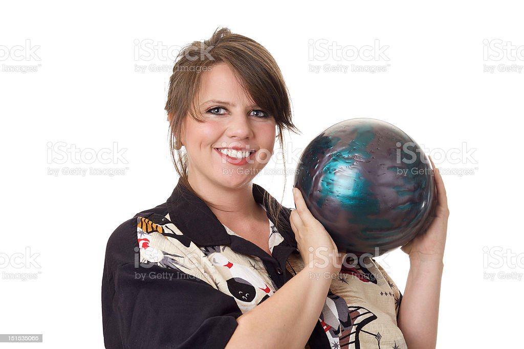 Young happy woman holding a bowling ball royalty-free stock photo