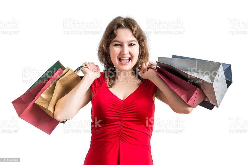 Young happy woman holds many shopping bags in hands. stock photo