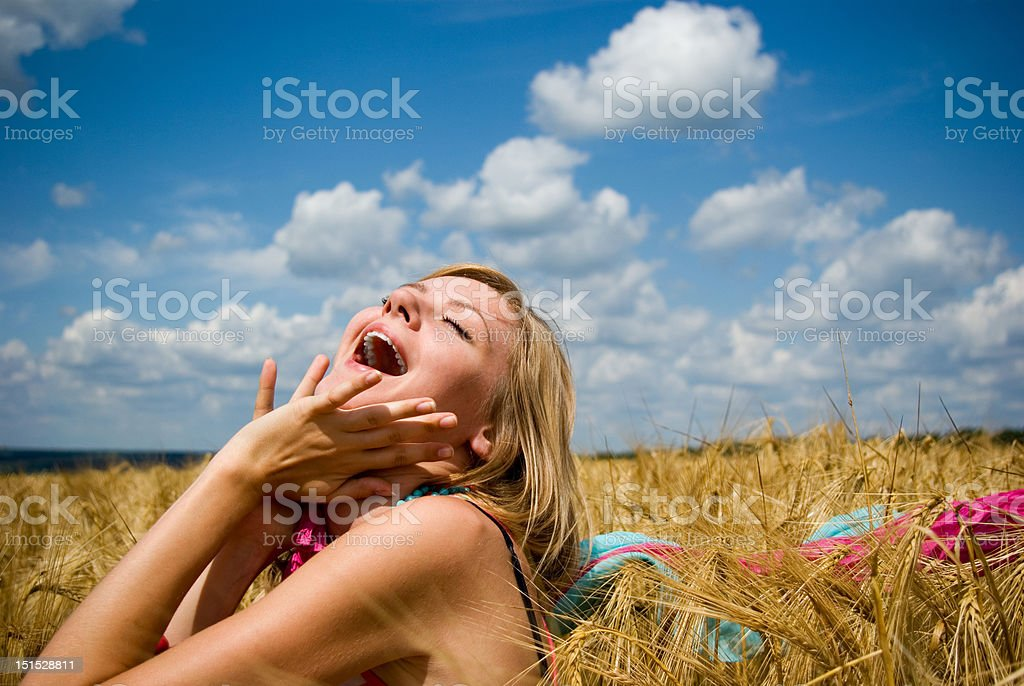 Young happy woman in field royalty-free stock photo
