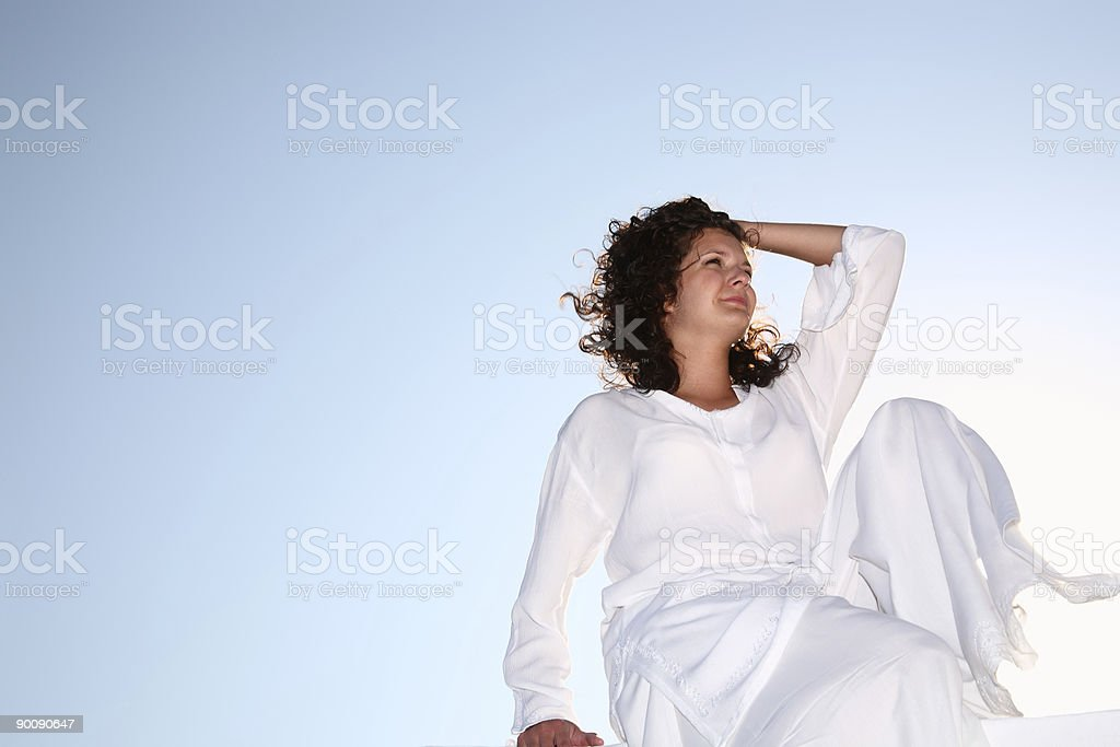 young happy woman in white royalty-free stock photo