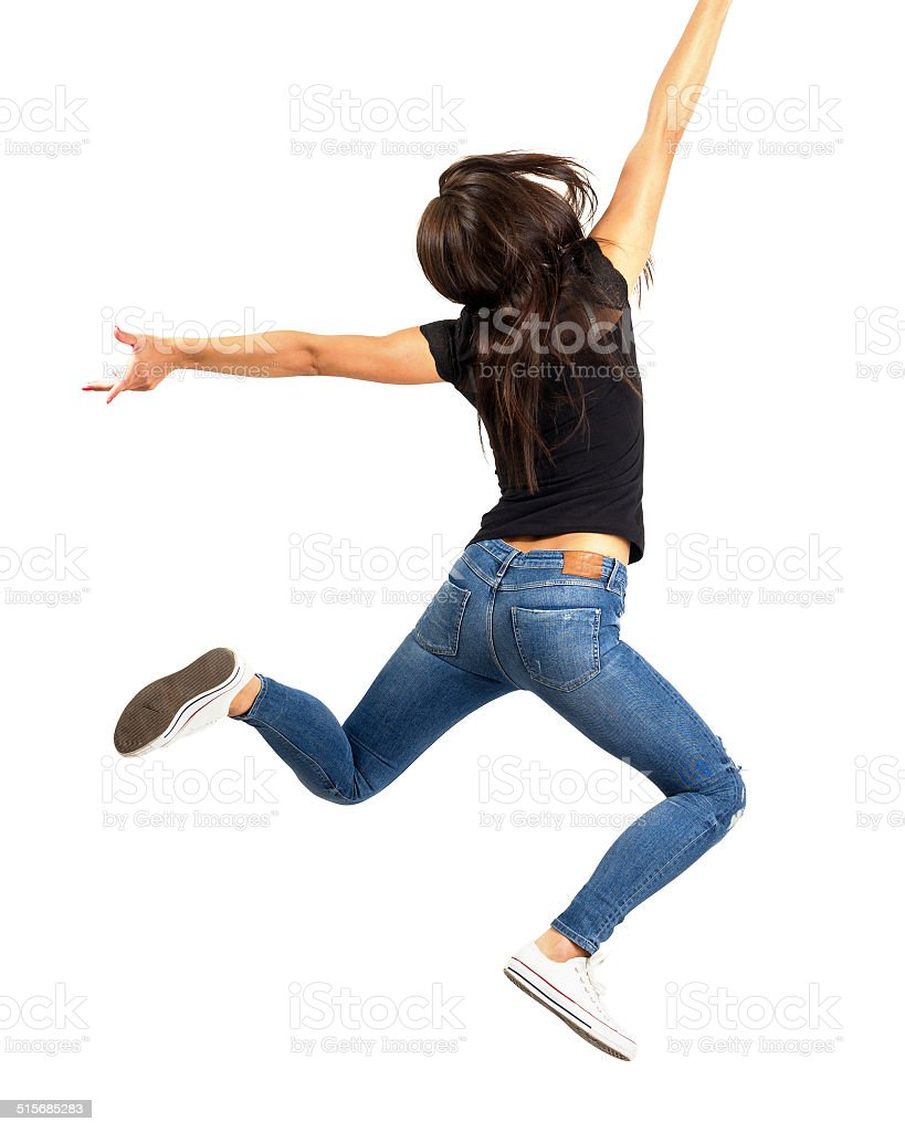 Young happy woman jumping out of frame. stock photo