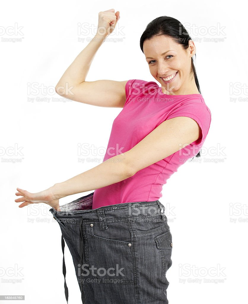 Young happy woman losing weight stock photo