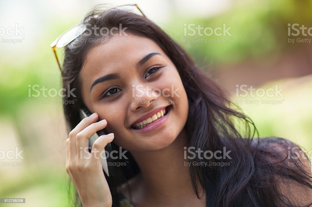 Young happy woman on the phone stock photo