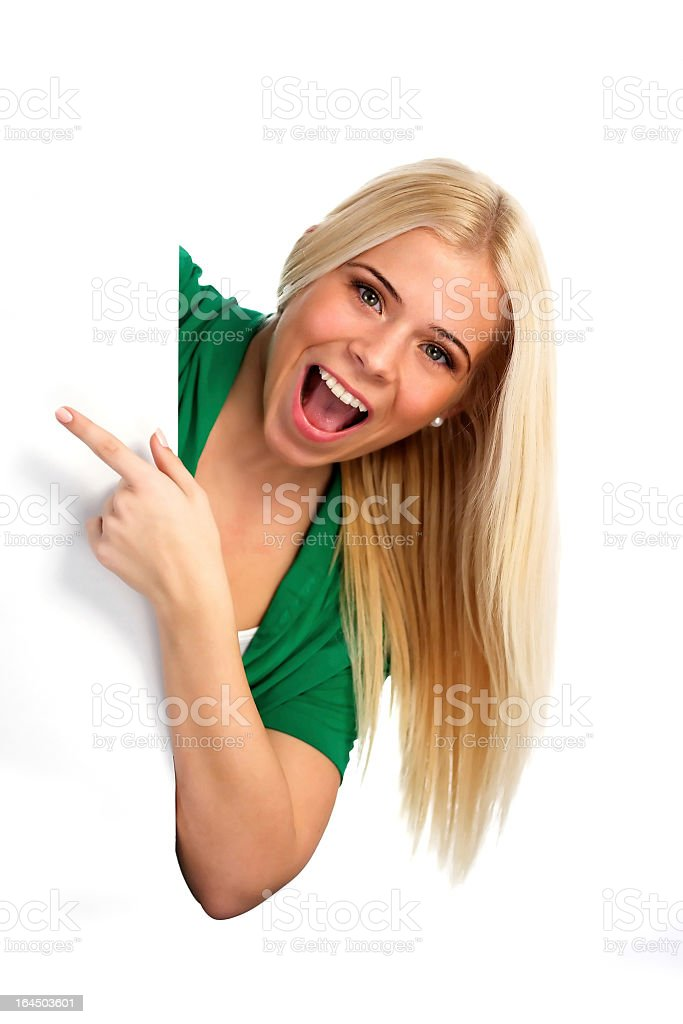 Young happy woman pointing at something royalty-free stock photo