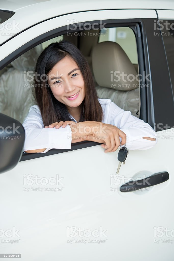 Young Happy Woman Showing The Key Of her New Car stock photo