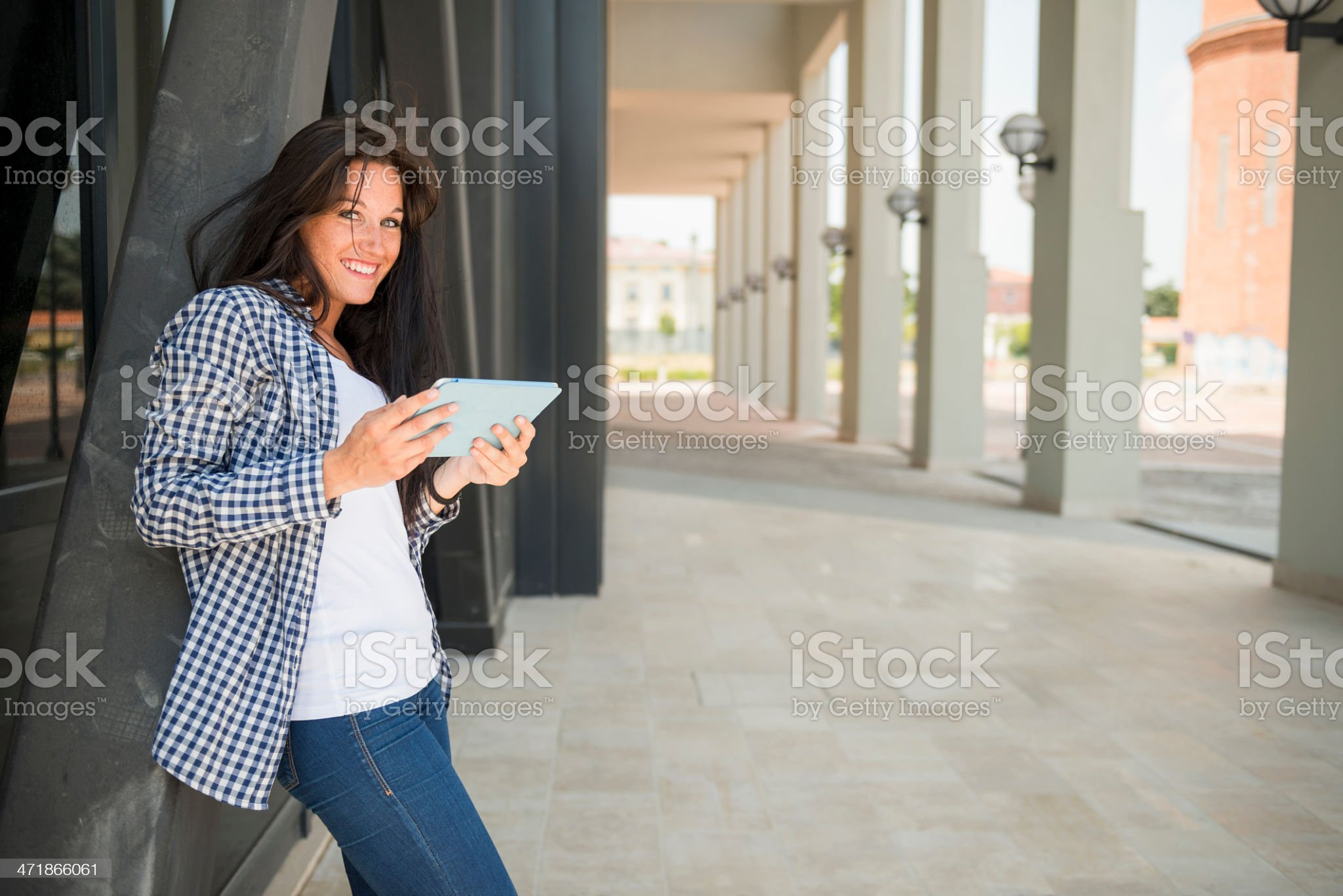 Young happy woman using digital tablet royalty-free stock photo