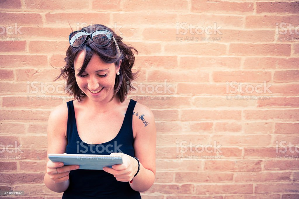 Young happy woman with digital tablet royalty-free stock photo