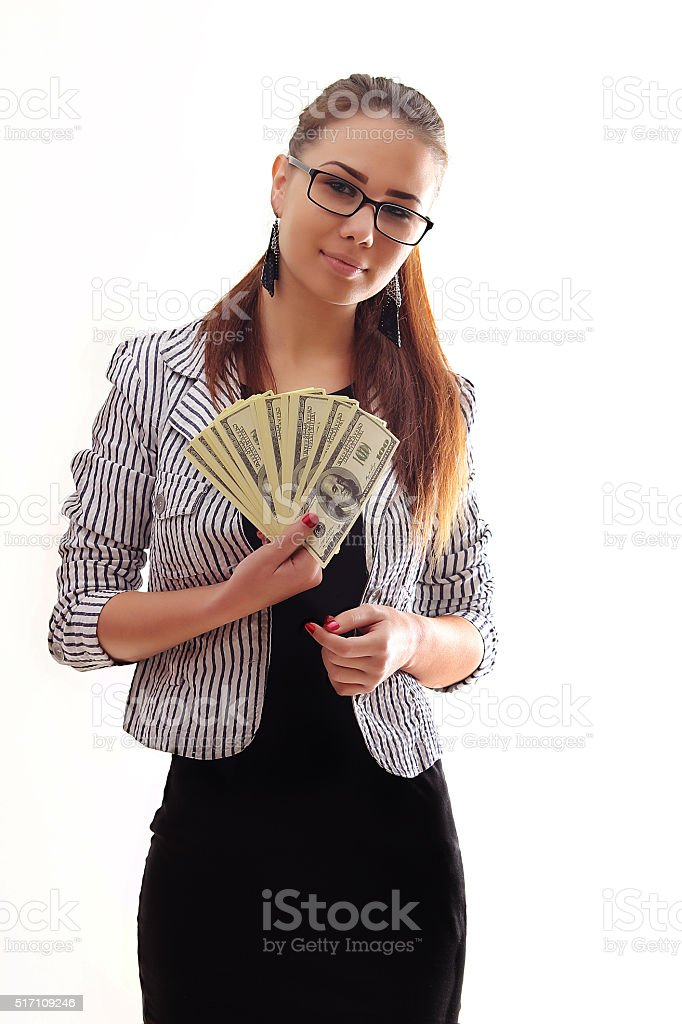 Young happy woman with dollars in hand. Isolated on white royalty-free stock photo