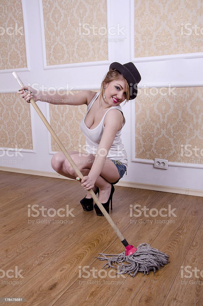 Young happy woman with mop in hand. looking at camera stock photo