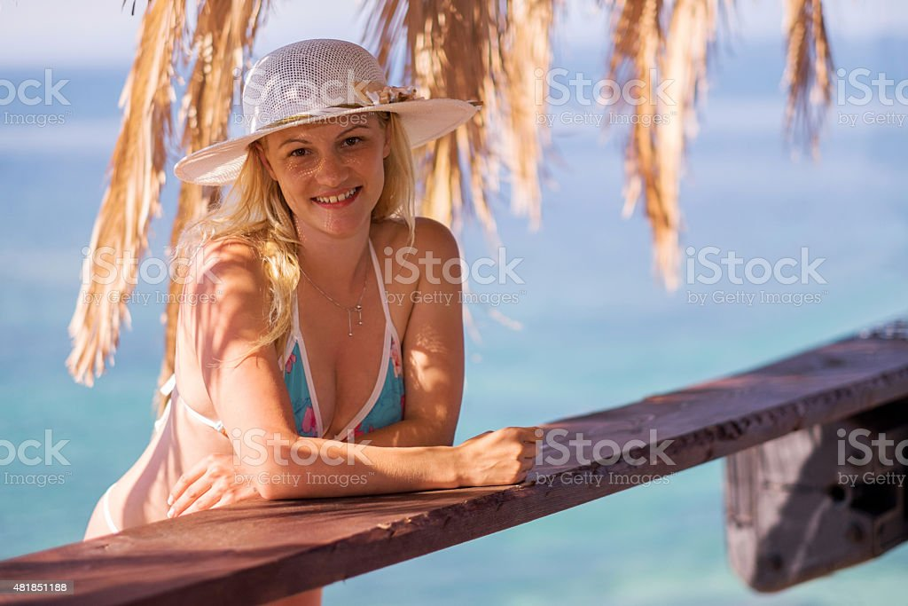 Young happy woman with sun hat enjoying in summer day. stock photo
