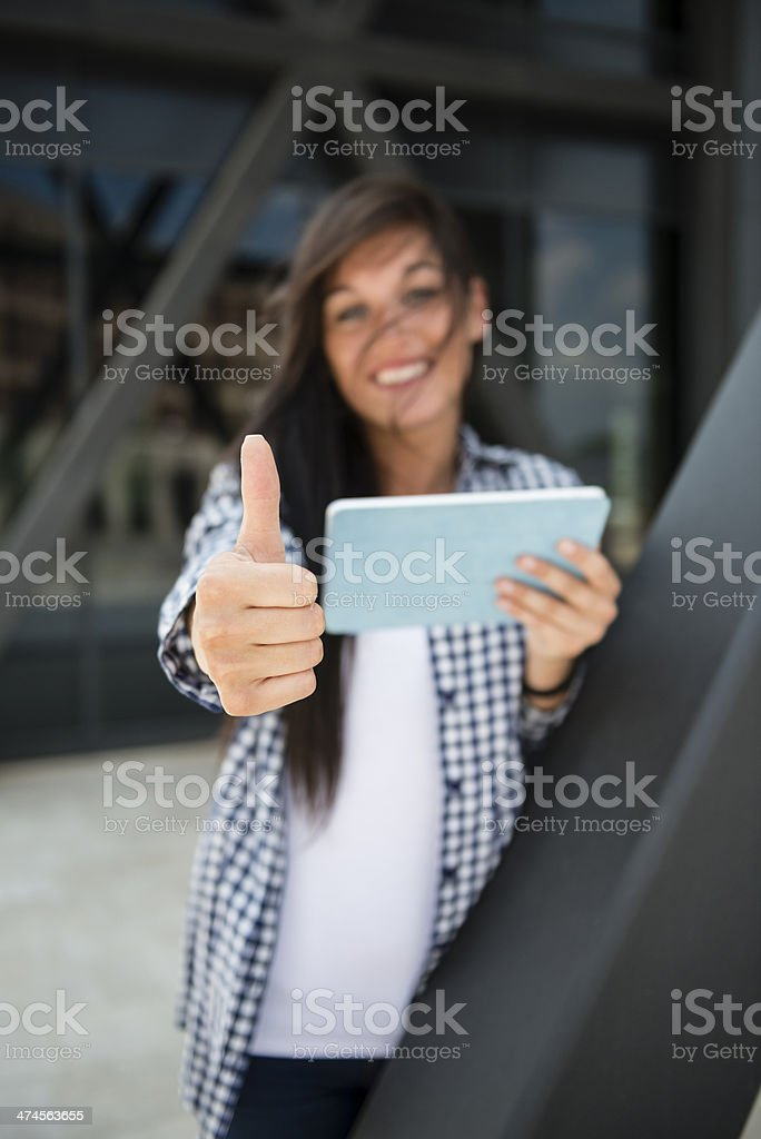 Young happy woman with thumbs up royalty-free stock photo