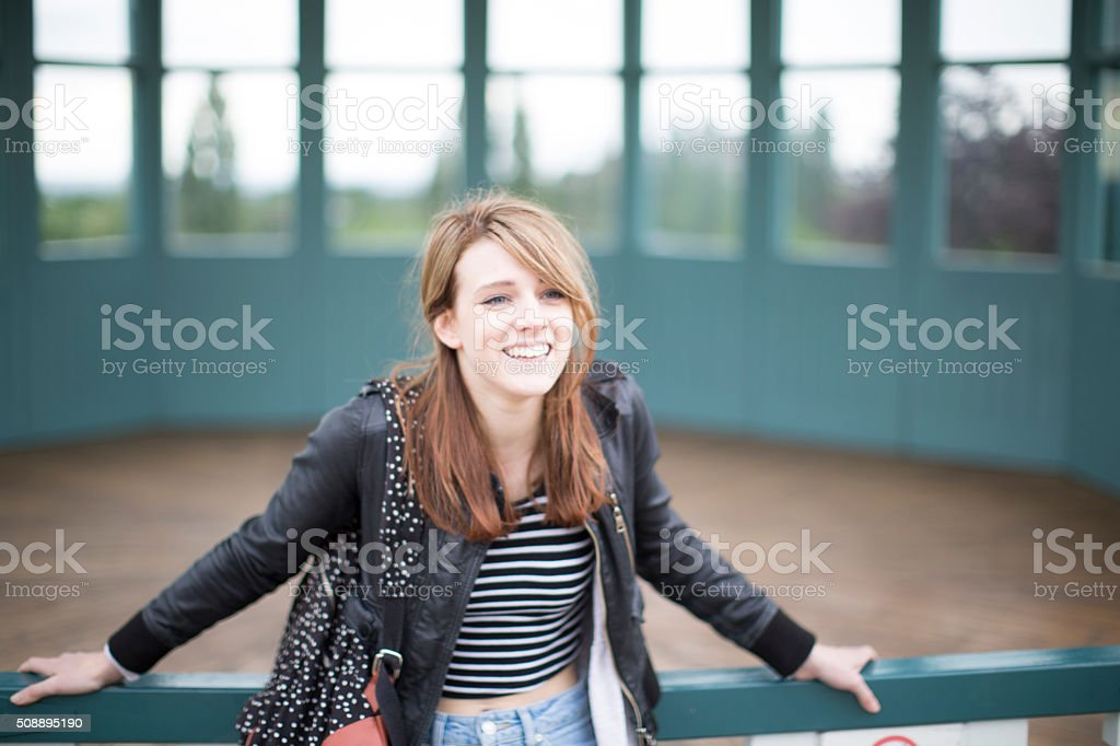 young happy women leaning stock photo