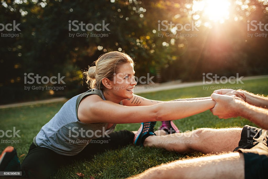 Young health couple exercising in park stock photo