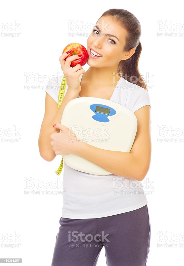 Young healthy girl with scales and apple stock photo