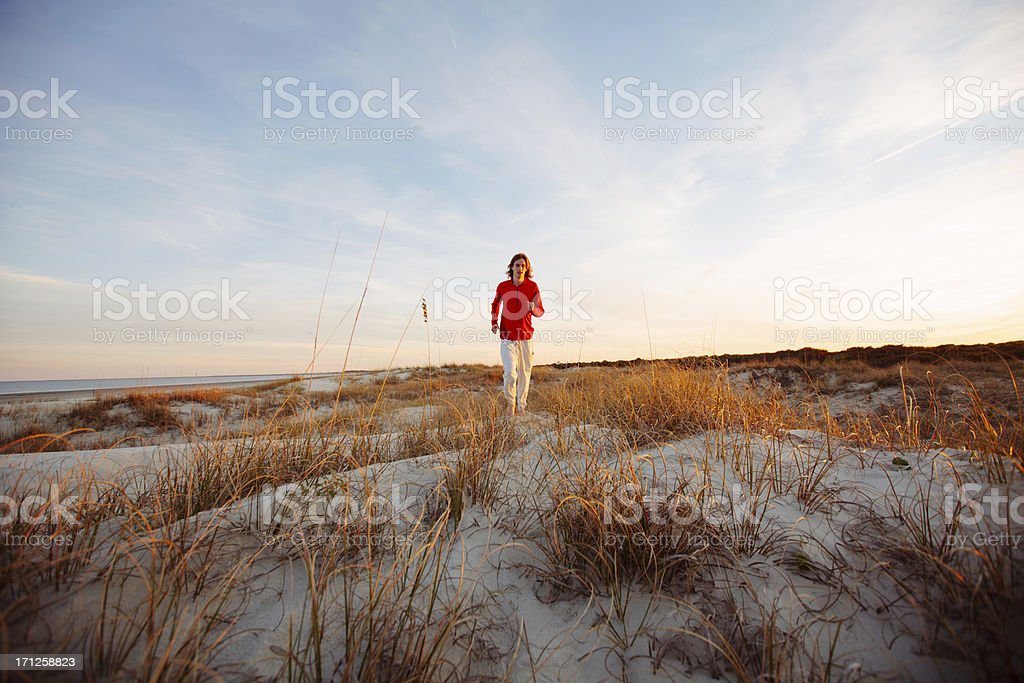 Young healthy man running on the beach royalty-free stock photo